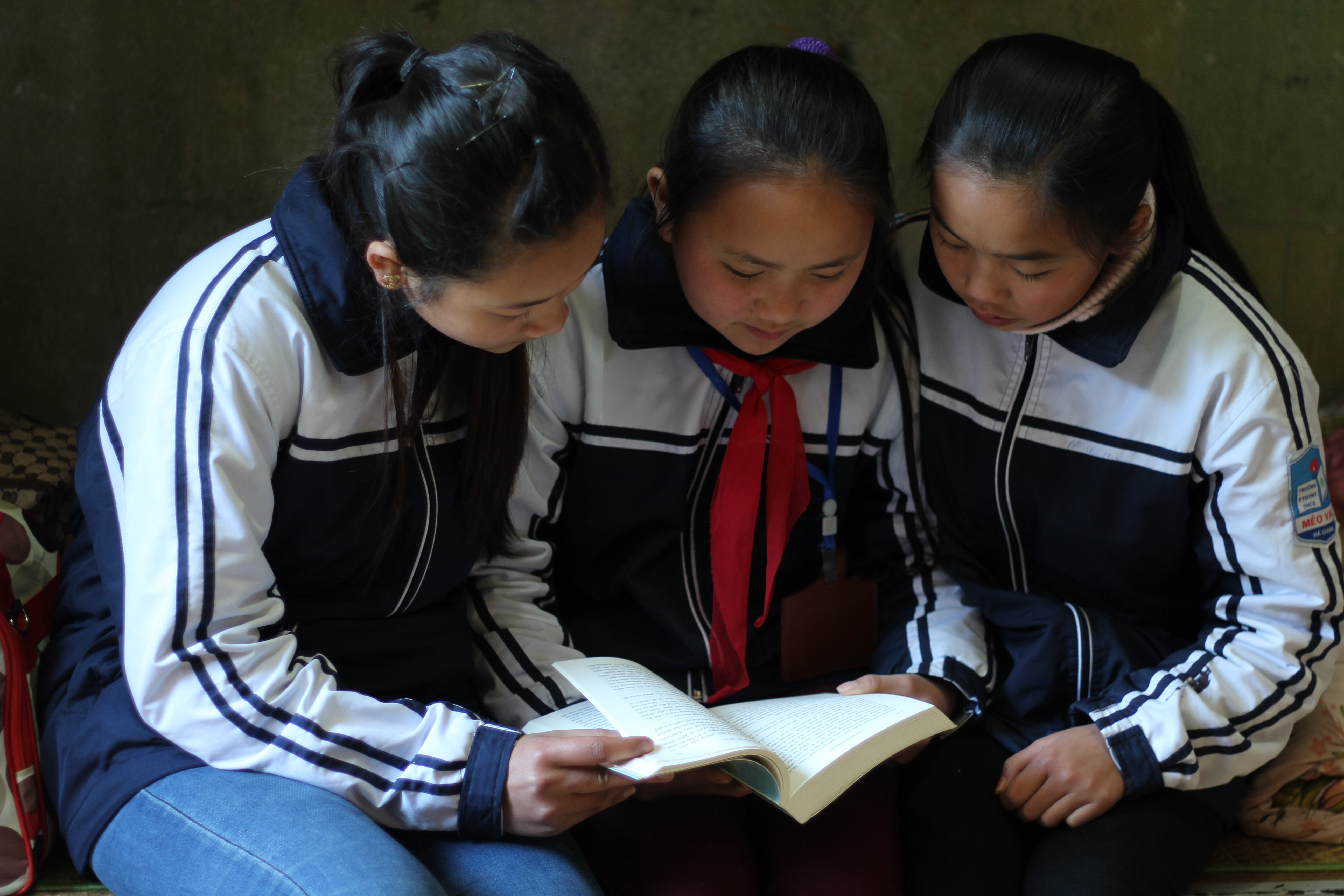 Cho and 2 female classmates studying ∏ Plan International
