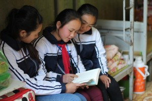 Cho and 2 female classmates studying 3 ∏ Plan International